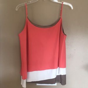 Cute tank great for business/casual.